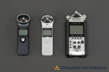 a grey, white, and professional digital field recorder